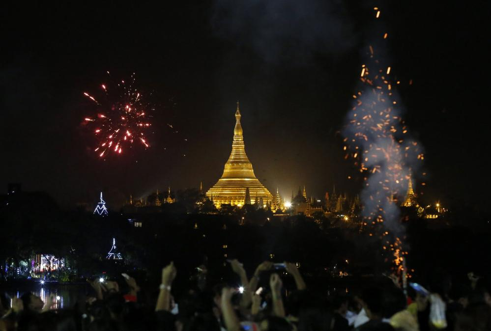 Fireworks illuminate the night sky over Myanmar's landmark Shwedagon pagoda