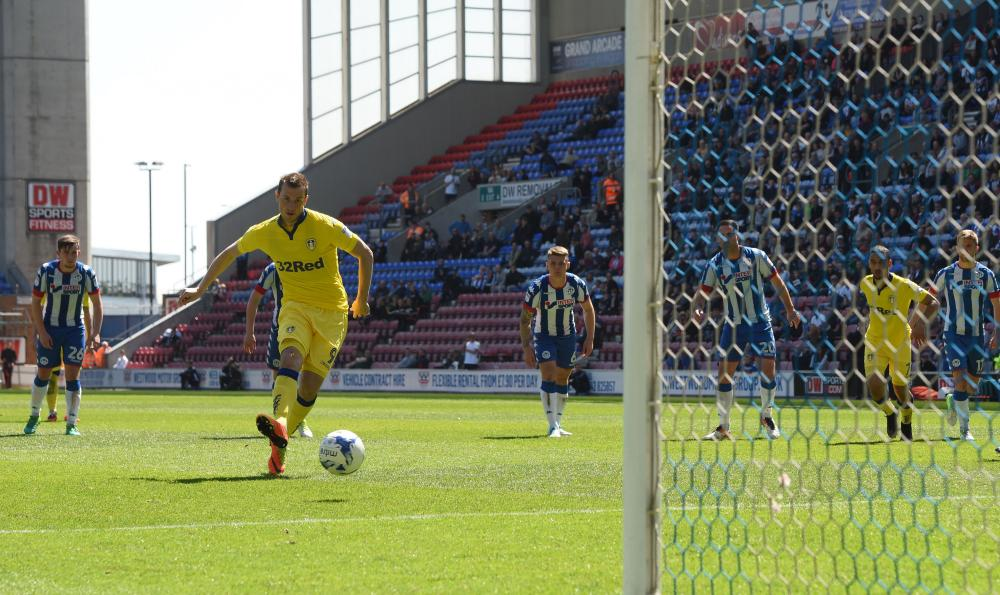Chris Wood scores the equaliser from the spot for Leeds.