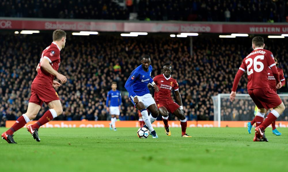 Liverpool players keep a close eye on Everton's Yannick Bolasie during the FA Cup clash at Anfield in January.