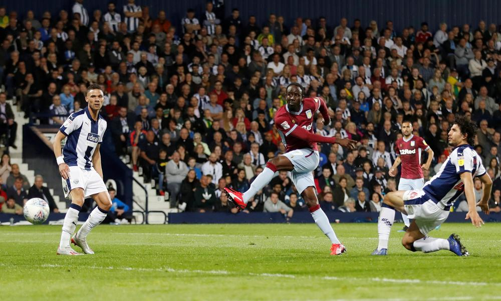 Aston Villa's Albert Adomah shoots at goal but is thwarted by Sam Johnstone between the Baggies' sticks.