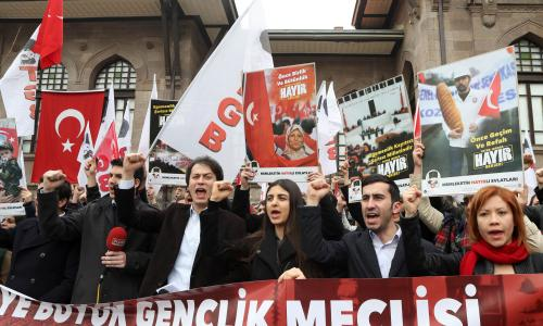 "Members of the Youth Union of Turkey shout slogans during a rally to call to vote ""NO"" in the April referendum on whether to boost the Turkish president's powers."