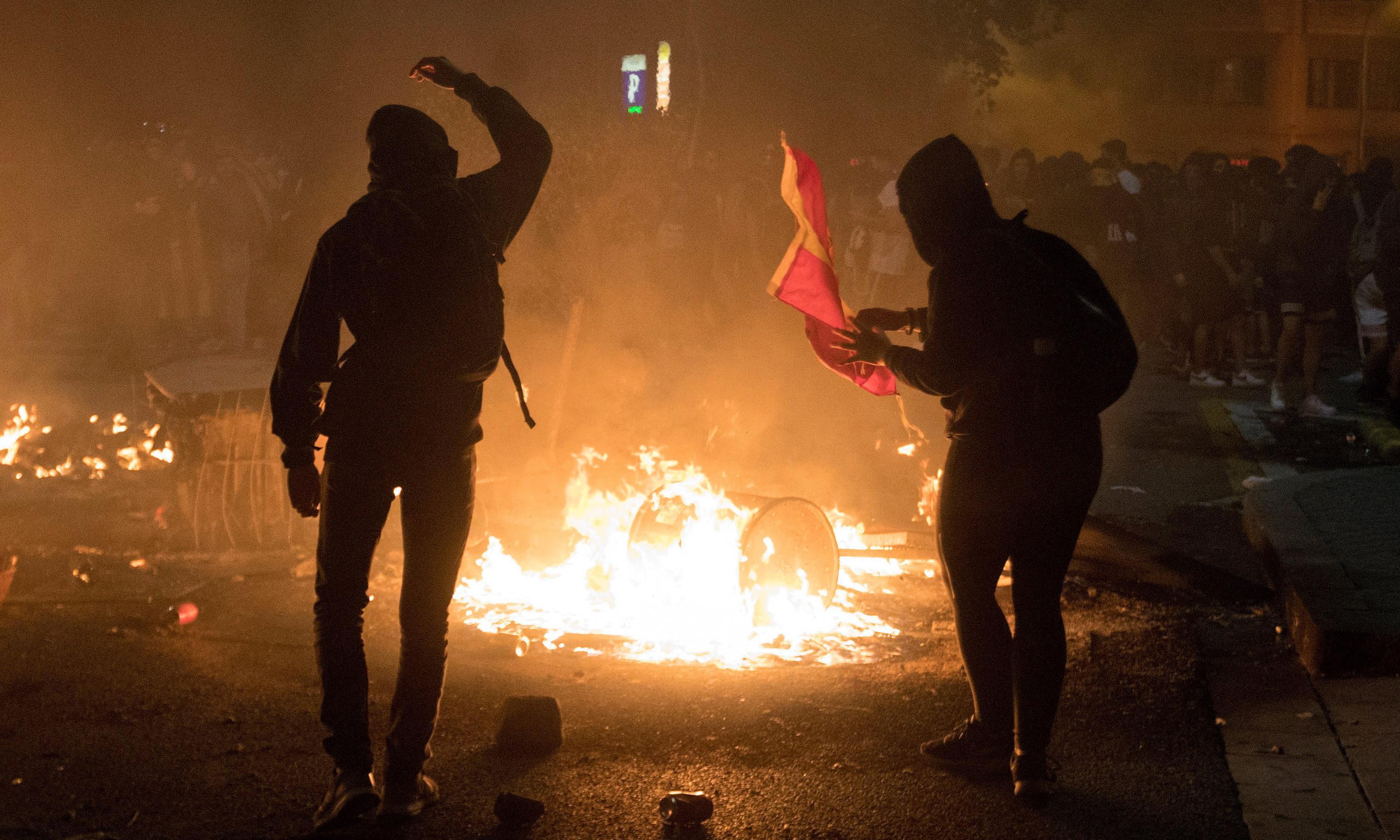Violence erupts after pro-Catalan general strike in Barcelona