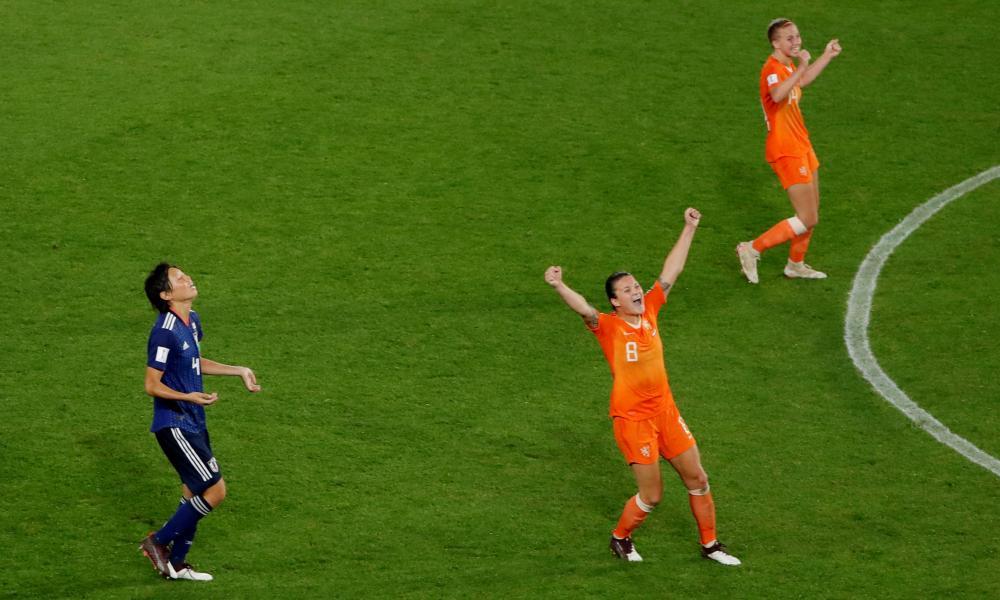 Netherlands' Sherida Spitse (no 8) celebrates as Japan's Saki Kumagai, who gave away the penalty, looks dejected.
