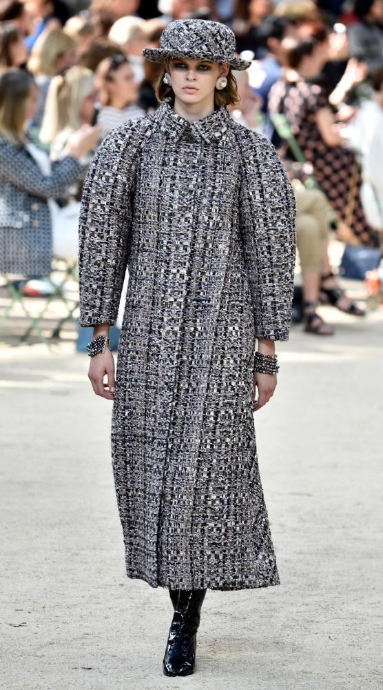 A long-line tweed coat with matching boater hat.