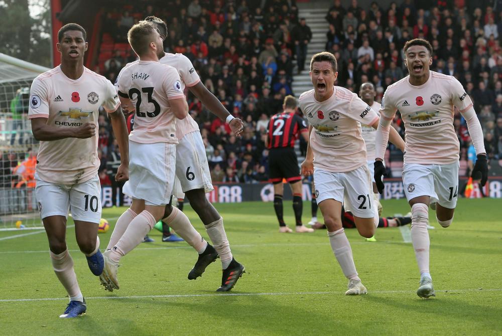 Rashford celebrates after his injury-time goal.
