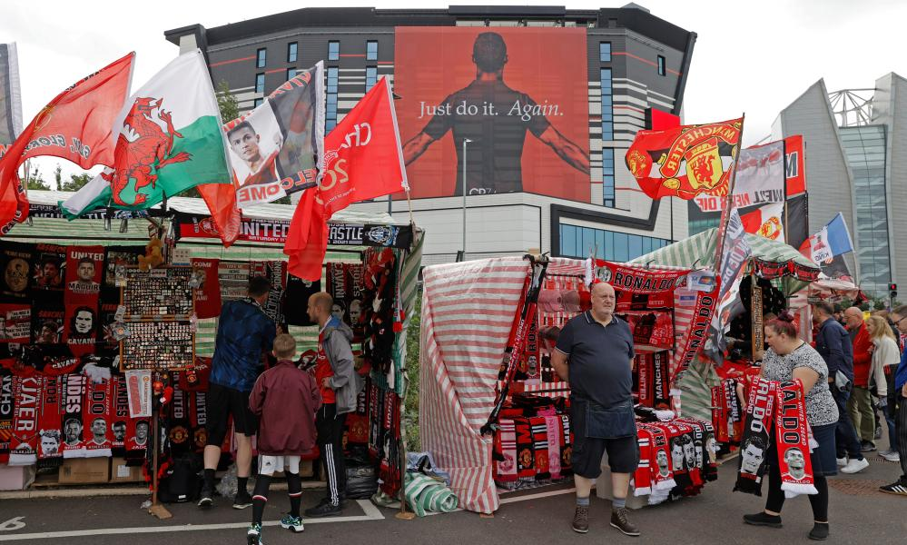 No doubt these merchandise sellers outside the ground will be doing a brisk trade today.