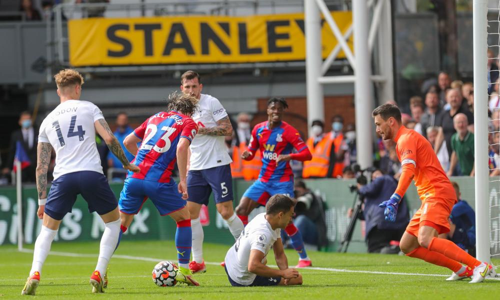 Spurs keeper Hugo Lloris (right) readies himself to make a save from Palace's Conor Gallagher.