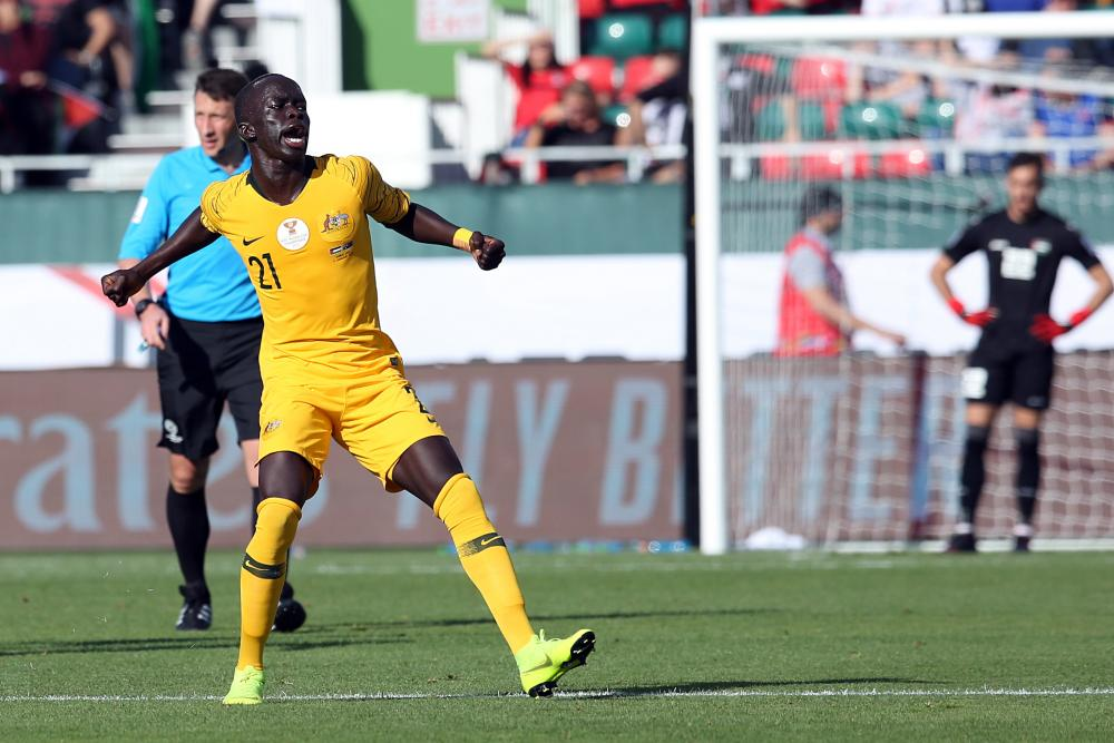 Awer Mabil of Australia celebrates scoring during the 2019 AFC Asian Cup group B soccer match between Palestine and Australia in Dubai.