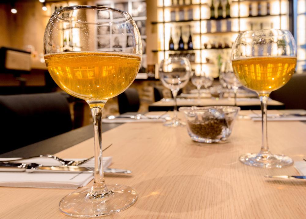 Glasses of cider on a table at Le Comptoir Breizh Café, Saint-Malo, France
