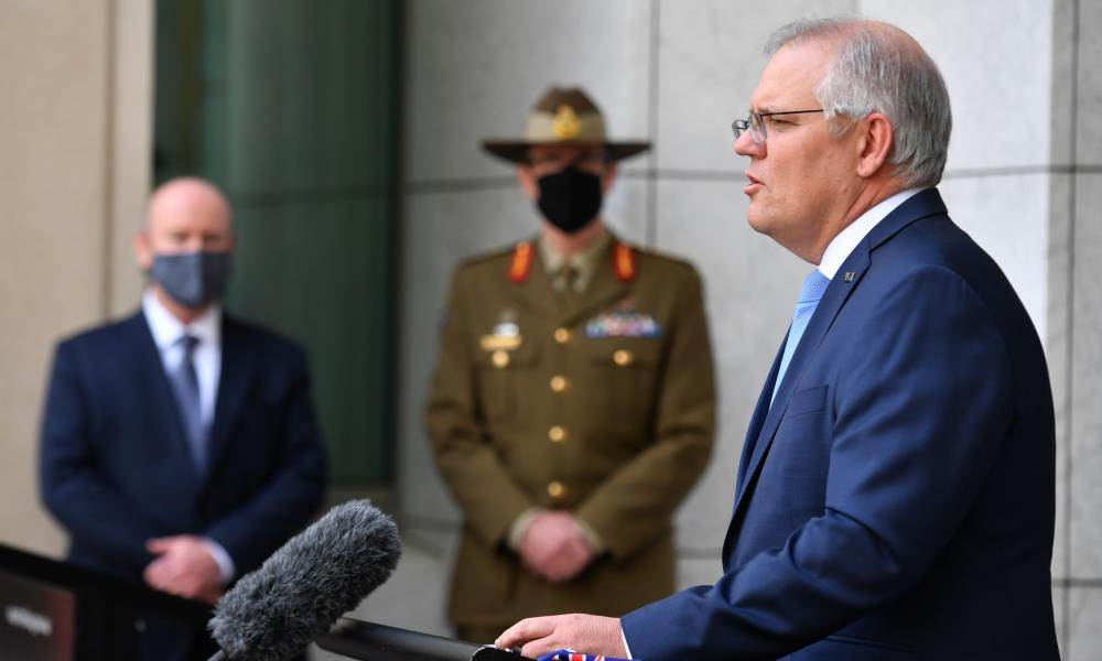 Scott Morrison at Thursday's press conference in Canberra alongside defence secretary Greg Moriarty and chief of the Australian Defence Force General Angus Campbell