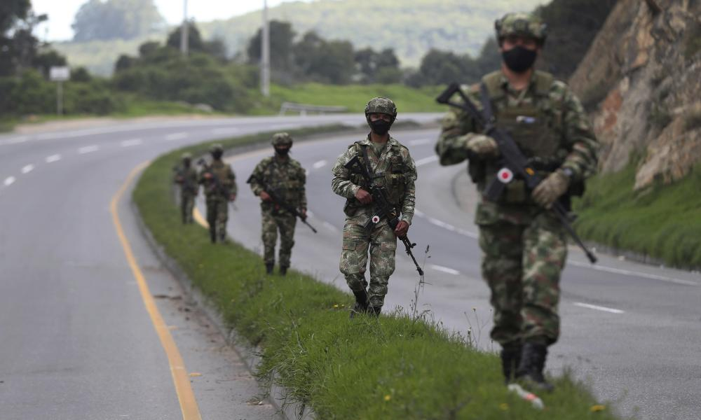 Soldiers patrol the outskirts of Bogota amid a reinstated strict lockdown to help curb the spread of coronavirus, in Bogota, Colombia.