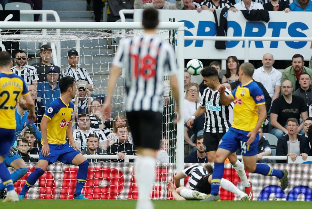Newcastle United's Ayoze Perez scores their third goal to complete his hat-trick.