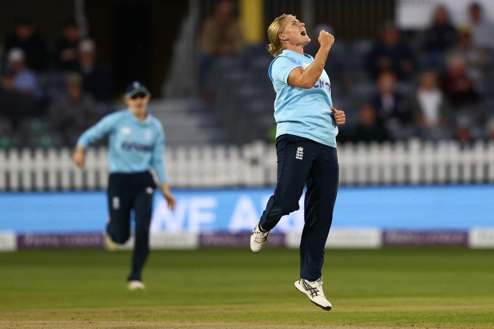 Katherine Brunt of England celebrates taking the wicket of Hannah Rowe of New Zealand.