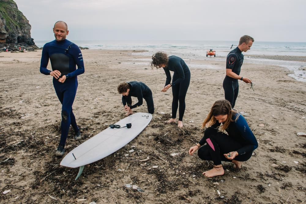 Hugo Tagholm, Dominic Ferris, Ellie Ewart, Sally Fish and Harry Dennis (left to right) collect pieces of plastic pollution and other litter along Porthtowan Beach.