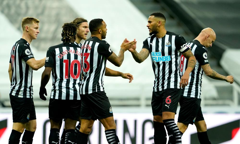 Newcastle players celebrate their first goal