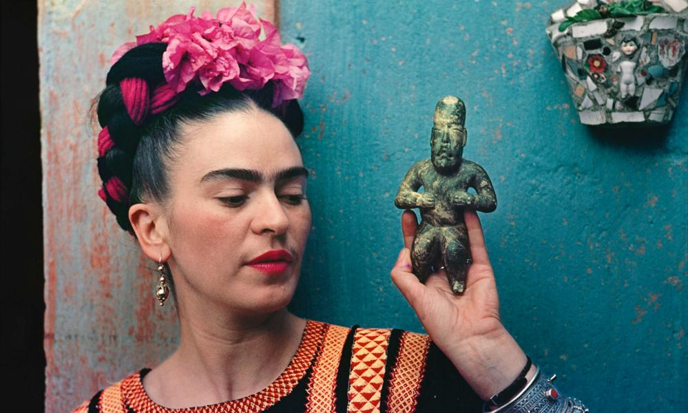 Kahlo with Olmec figurine, 1939.