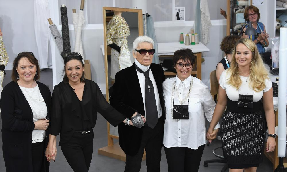 Karl Lagerfeld poses with Chanel's seamstresses the Chanel haute couture show.