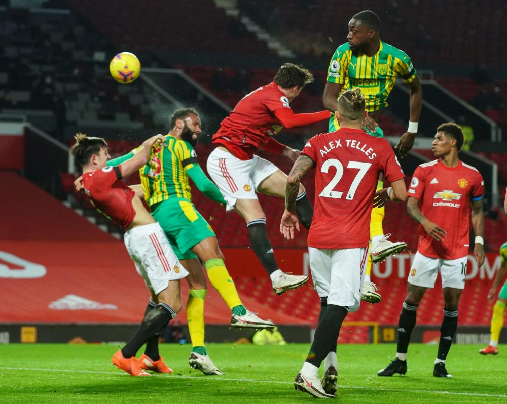 Kyle Bartley of West Bromwich Albion (second left) heads at goal.