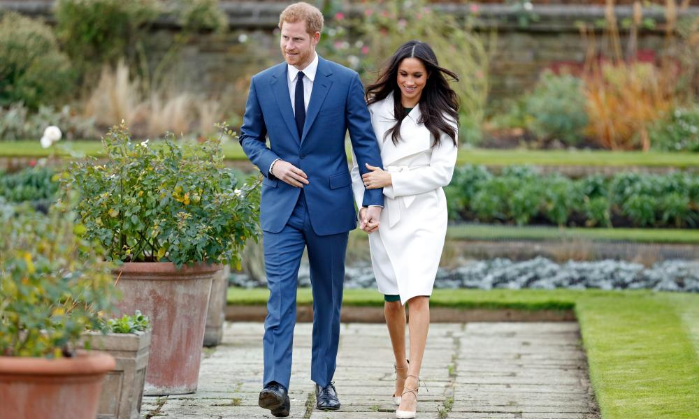 Meghan Markle in a white trench for the announcement of her engagement to Prince Harry.