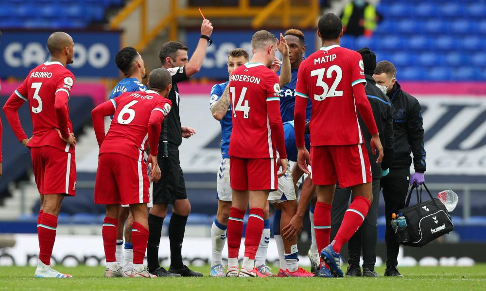 Richarlison is shown a red card by referee Michael Oliver after a challenge on Liverpool's Thiago Alcântara