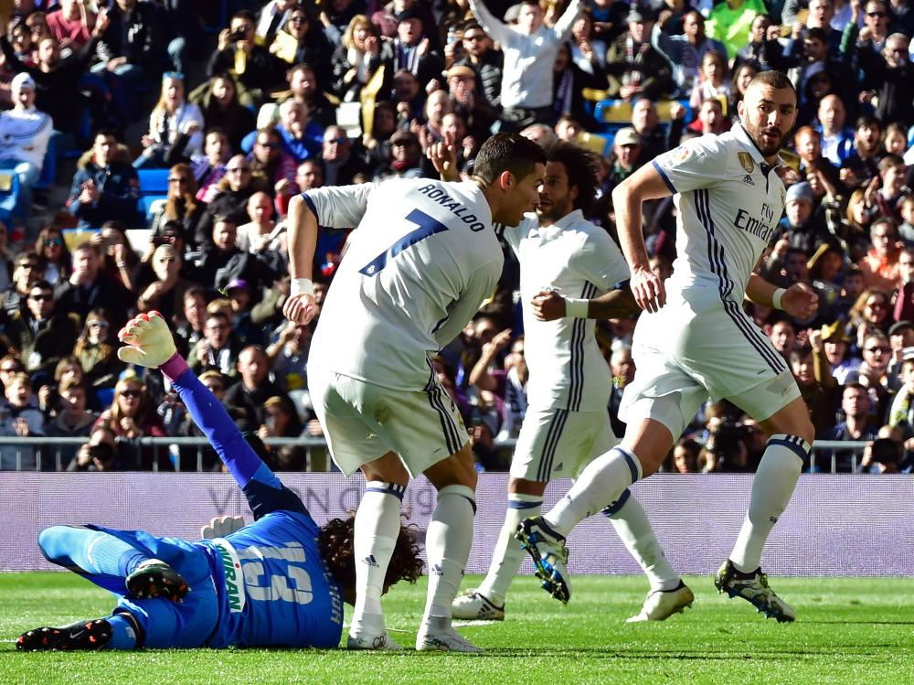 Karim Benzema turns away to celebrate after scoring the second.