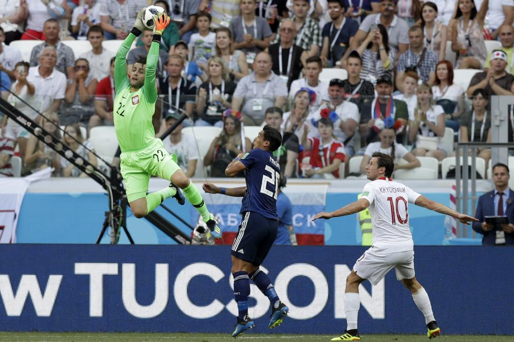 Lukasz Fabianski makes a save against Japan.