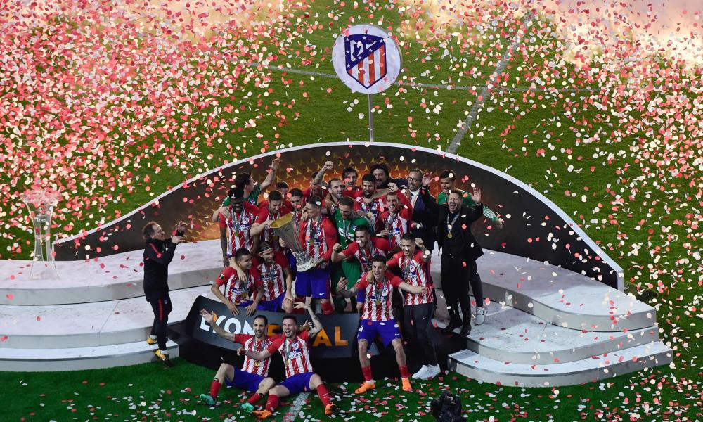 Atletico's players pose with the trophy after winning the Europa League final.