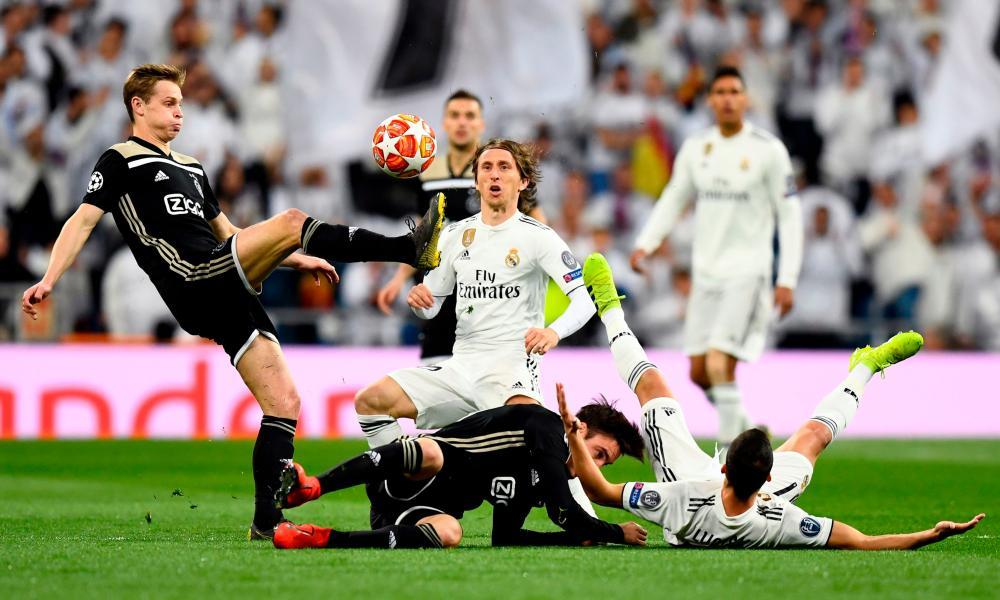 Ajax's Frenkie de Jong clears the ball away from Real Madrid's Luka Modric.