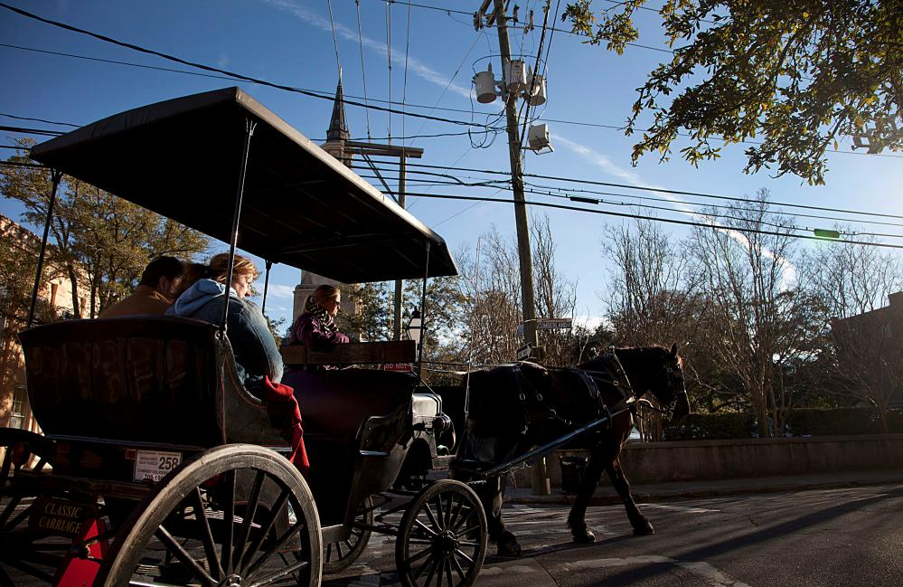 No 2 on the list: tourists take a horse drawn carriage ride through the historic area in Charleston, South Carolina.