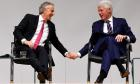 Tony Blair and Bill Clinton hold hands an event to celebrate the 20th anniversary of the Good Friday Agreement, in Belfast, Northern Ireland, April 10, 2018. REUTERS/Clodagh Kilcoyne     TPX IMAGES OF THE DAY