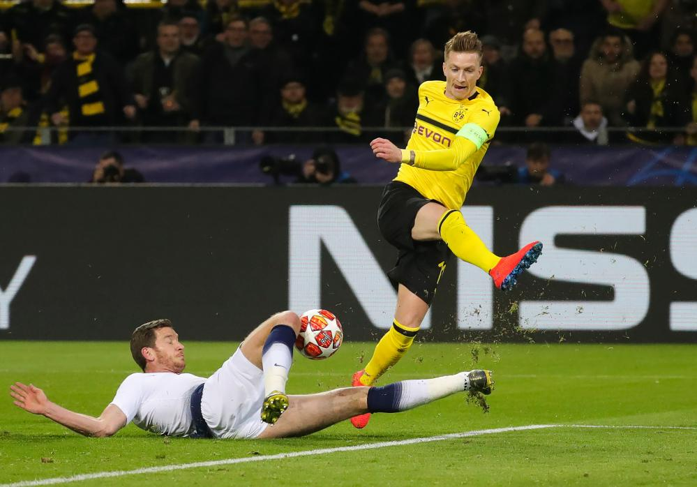 Dortmund's Marco Reus is thwarted by Tottenham's Jan Vertonghen.