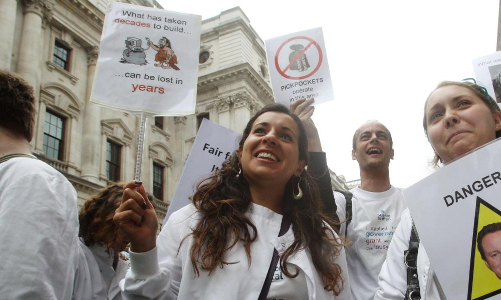 Scientists march outside the Treasury in 2010
