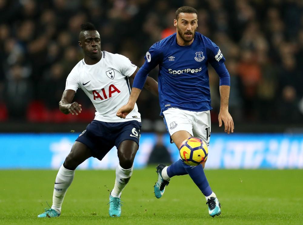 Cenk Tosun of Everton surges past Davinson Sanchez of Tottenham Hotspur.