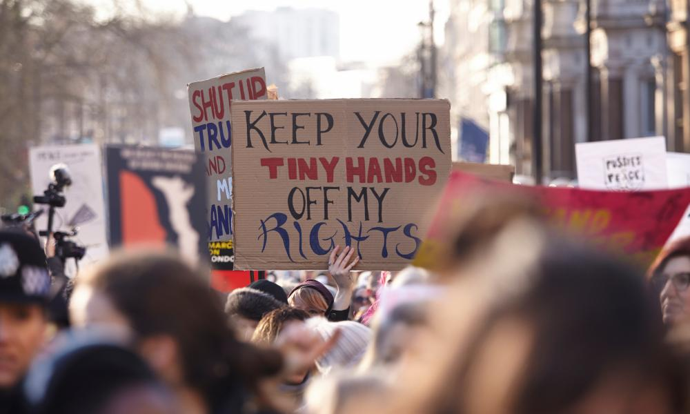 A placard is held aloft during the march in London.