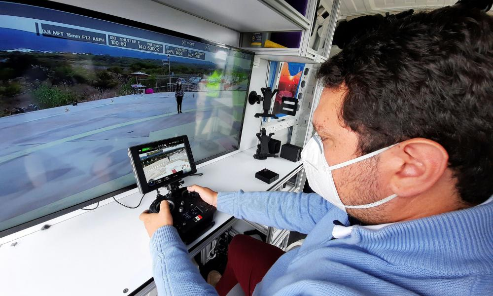 A drone pilot of Sintonia Logistica controls a drone loaded with personal protective gear and other essential equipment whilst delivering to a public hospital, in Queretaro, Mexico.