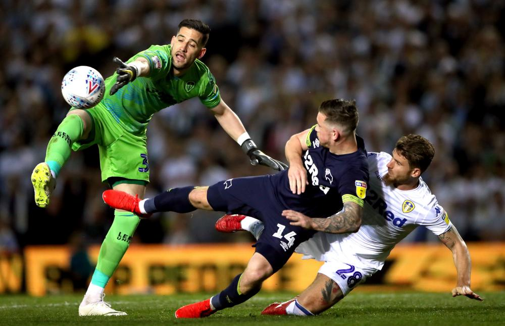 Casilla attempts to collect as Marriott goes to ground with Berardi.