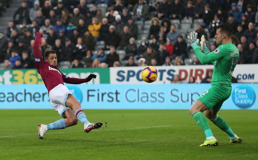 West Ham's Javier Hernandez scores in the eleventh minute.