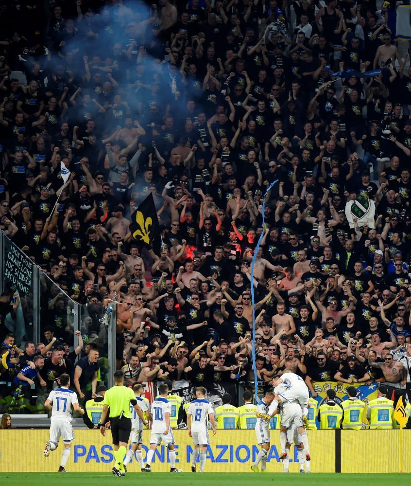 Bosnia & Herzegovina's Edin Dzeko celebrates scoring their first goal with teammates.