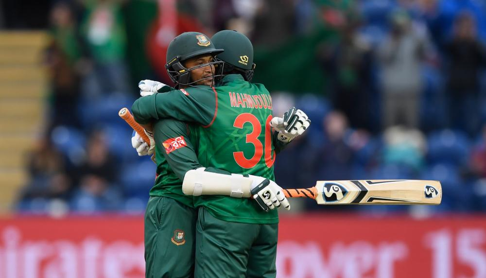 Shakib emabraces Mahmudullah after reaching a century.