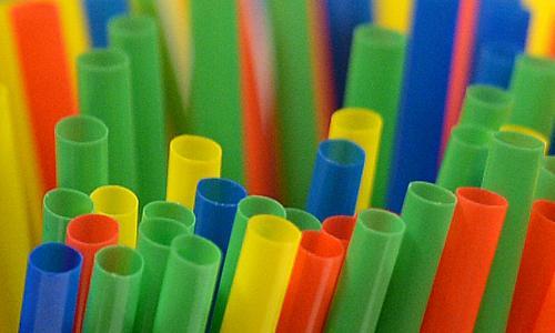 Assortment of coloured plastic straws.