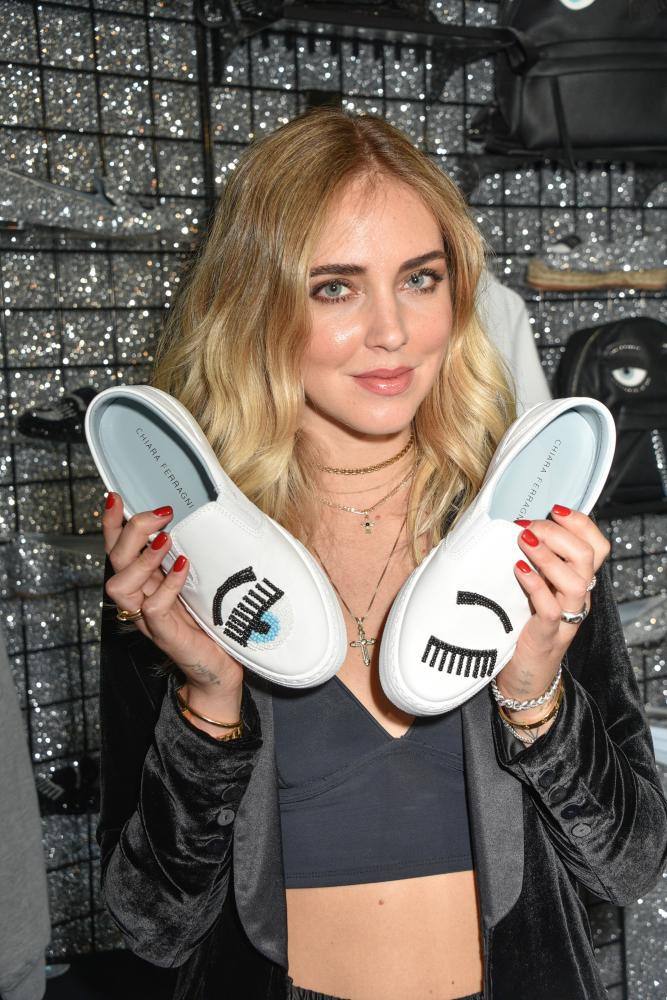 Chiara Ferragni with a pair of her shoes at the Chiara Ferragni Pop-Up Shop in Los Angeles, November 2016