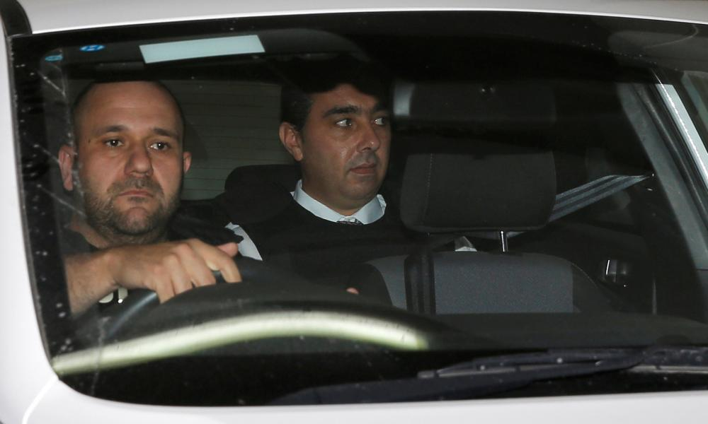 Melvin Theuma being driven in a police car from the courts of justice in Valletta on 4 December 2019.