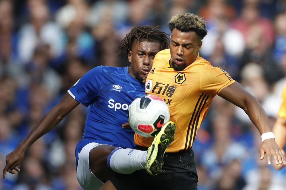 Adama Traoré vies for the ball with Alex Iwobi during Wolves' defeat at Everton.