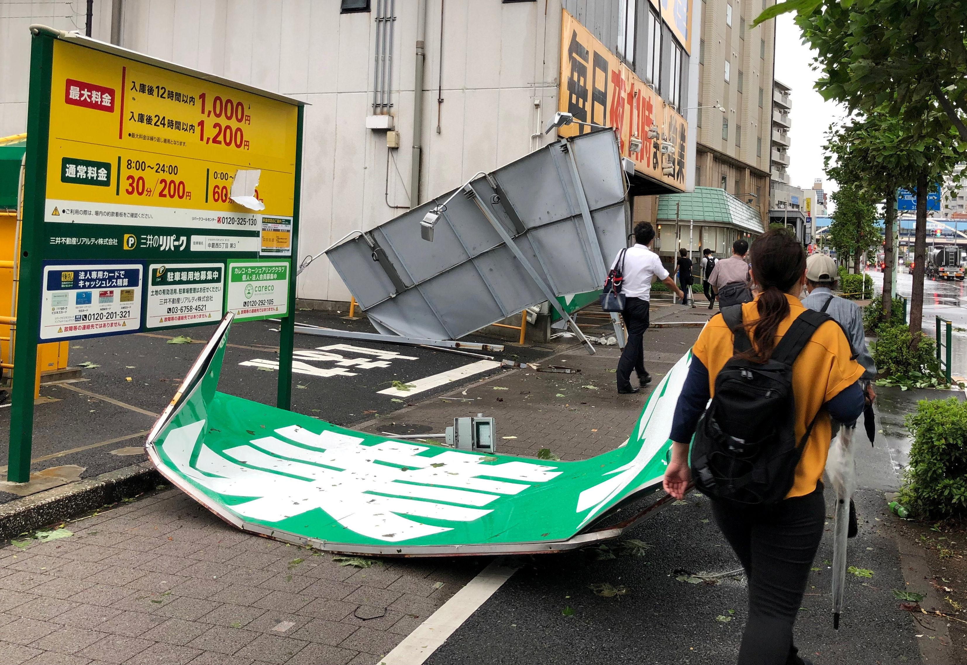 Typhoon Faxai batters Tokyo, causing evacuations, blackouts and transport chaos