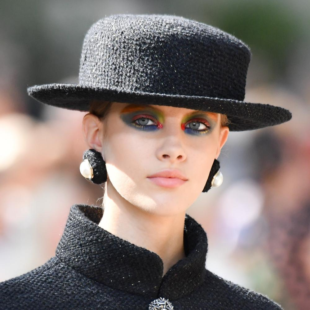 Tweed hats, giant earrings and rainbow ombré eye shadow.