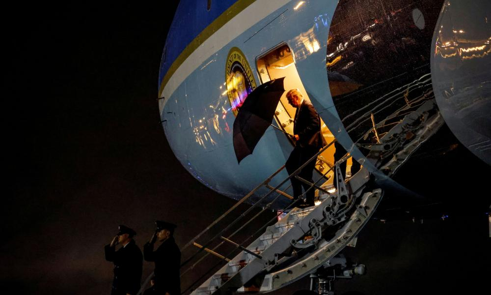 Donald Trump disembarks Air Force One upon arriving at Joint Base Andrews, Maryland, after returning from the first presidential debate.