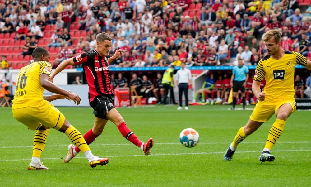 Florian Wirtz of Bayer Leverkusen sopens the scoring against Borussia Dortmund.