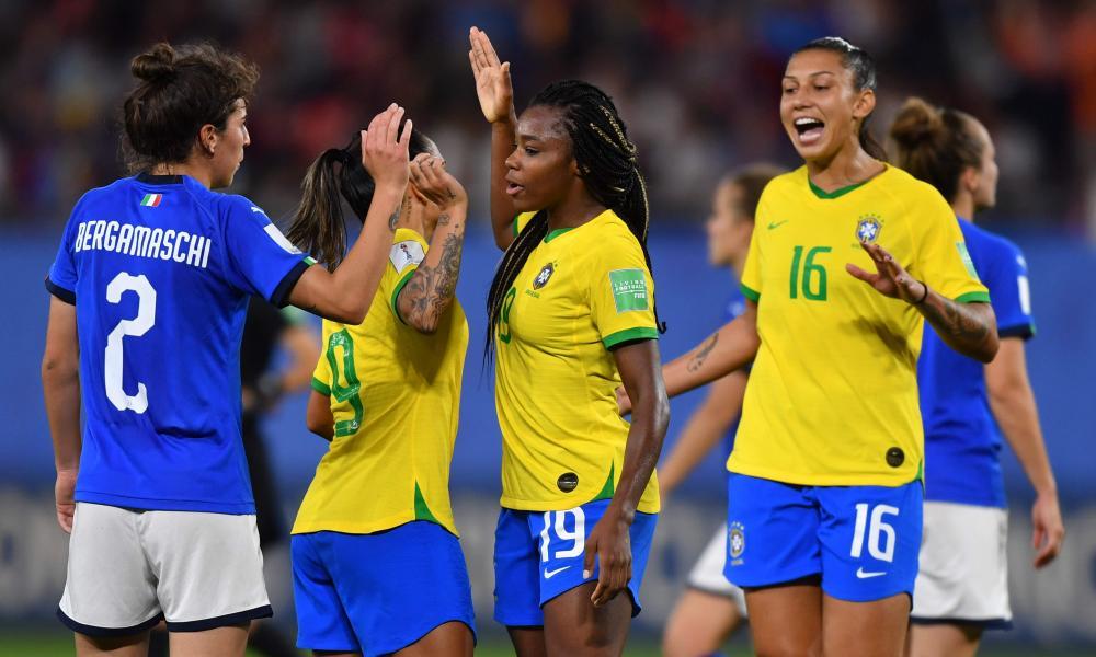 Valentina Bergamaschi congratulates Brazil's Ludmila da Silva and Beatriz at the end of the match.