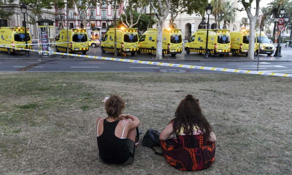 Van Hits Crowds In Barcelona's Las RamblasBARCELONA, SPAIN - AUGUST 17: People look toward the scene of a terrorist attack in the Las Ramblas area on August 17, 2017 in Barcelona, Spain. Officials say 13 people are confirmed dead and at least 50 injured after a van plowed into people in the Las Ramblas area of the city. (Photo by David Ramos/Getty Images)