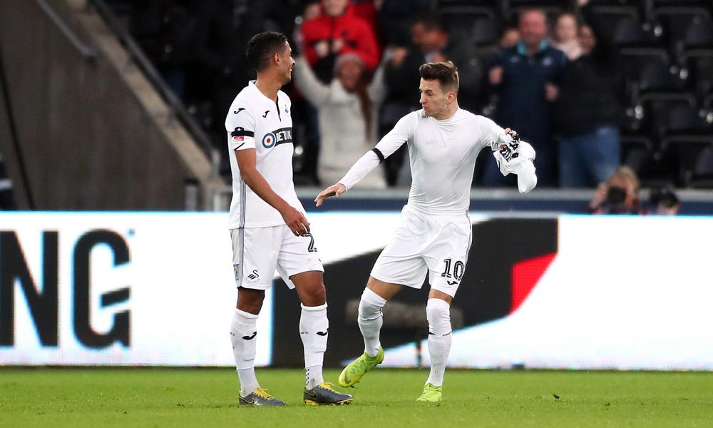 Swansea City's Bersant Celina (right) celebrates scoring his side's third goal against Brentford.